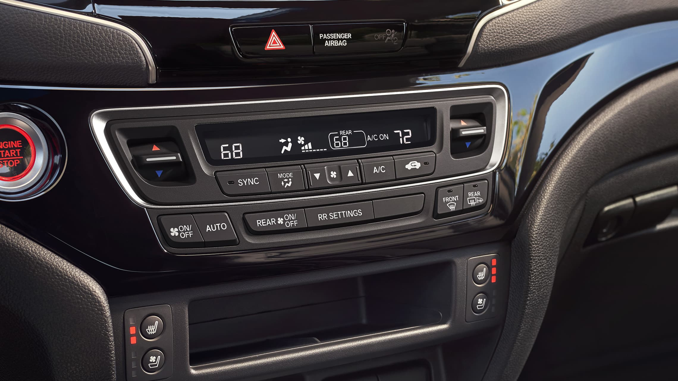 Tri-zone automatic climate control detail on the 2021 Honda Passport Elite with Black Leather interior.